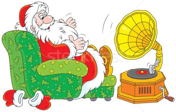 Santa Claus listening to music Stock photo © AlexBannykh