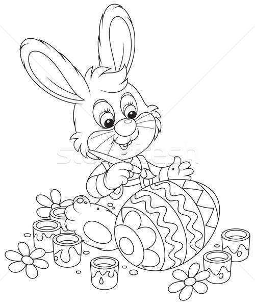 Little Bunny paints an Easter egg Stock photo © AlexBannykh