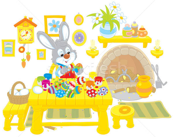 Bunny paints Easter eggs Stock photo © AlexBannykh