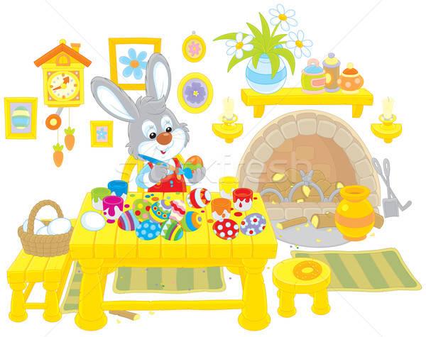 Bunny paints Easter eggs Stock photo © AlexBannykh