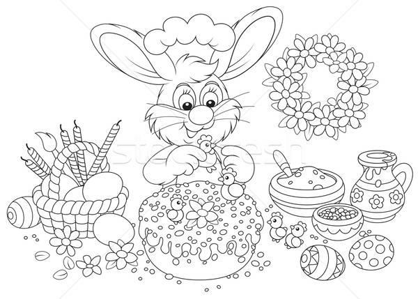 Easter bunny decorates a fancy cake Stock photo © AlexBannykh