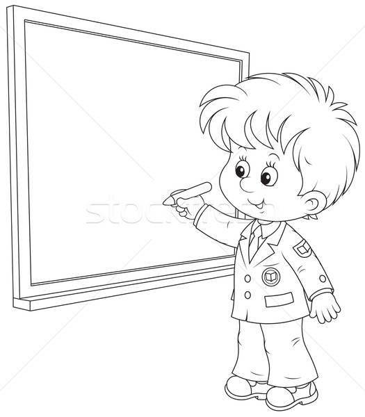 Schoolboy writes on the blackboard Stock photo © AlexBannykh