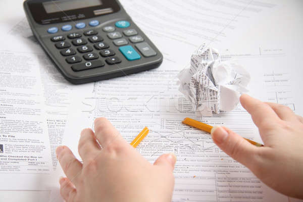 Suficiente frustrado contador papel tabela calculadora Foto stock © alexeys