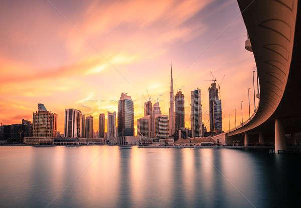 Stock fotó: Dubai · belváros · sziluett · festői · kilátás · naplemente