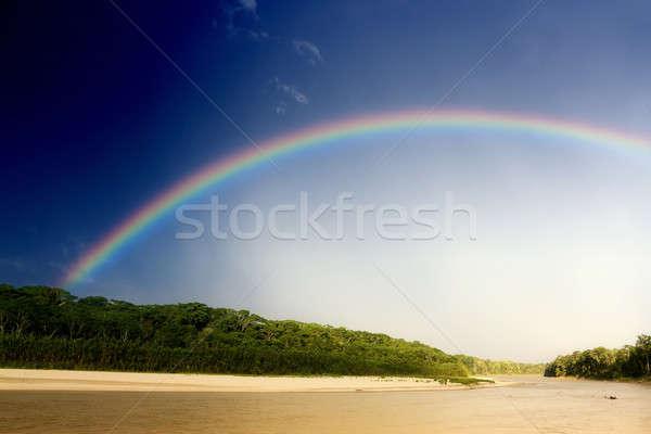 Rainbow over river Stock photo © alexeys