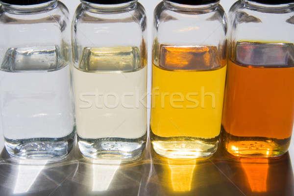 Olaj minták üvegek különböző olajok napfény Stock fotó © alexeys
