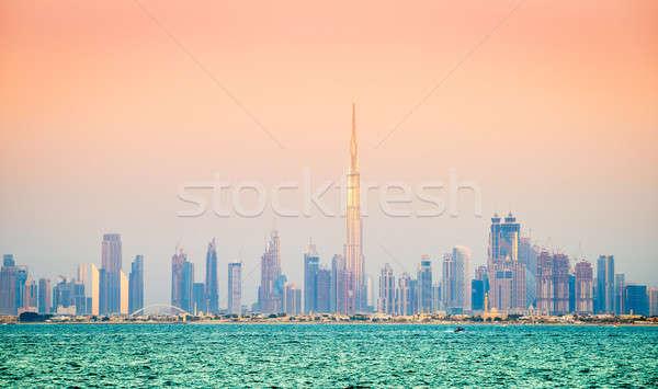 Dubai belváros sziluett vízpart kilátás naplemente Stock fotó © alexeys