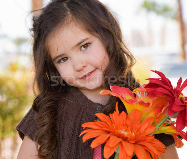 Little girl with flowers Stock photo © alexeys