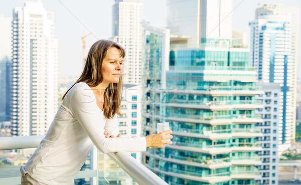 Woman on a highrise balcony Stock photo © alexeys