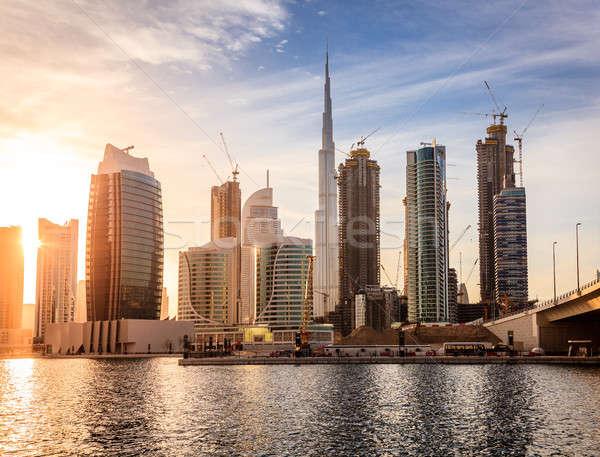 Dubai centro da cidade linha do horizonte cênico ver pôr do sol Foto stock © alexeys