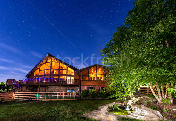 Huis nachtelijke hemel mooie moderne koi vijver Stockfoto © alexeys