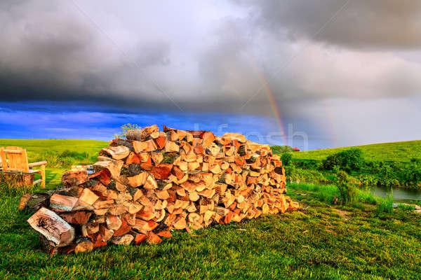 Drewno opałowe podwórko tęczy niebo chmury Zdjęcia stock © alexeys
