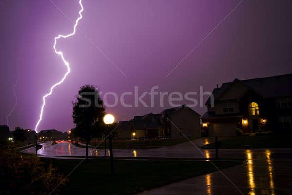 Onweersbui verscheidene bliksem staking regen gebouwen Stockfoto © alexeys