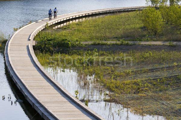 Biciklizés lovaglás este jelenet város park Stock fotó © alexeys