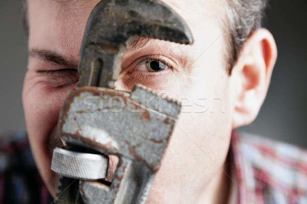 Vízvezetékszerelő közelkép kép arc cső franciakulcs Stock fotó © alexeys