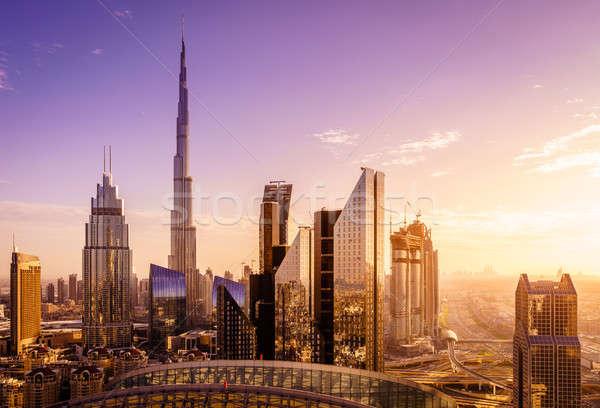 Dubai belváros sziluett kilátás naplemente égbolt Stock fotó © alexeys