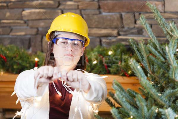 ünnep biztonság fiatal nő visel munkavédelmi sisak biztonsági szemüveg Stock fotó © alexeys