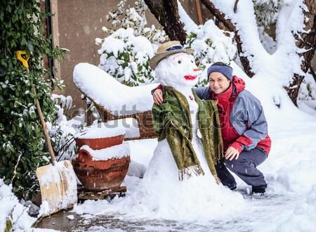 Sneeuwpop vrouw sneeuwstorm huis Stockfoto © alexeys