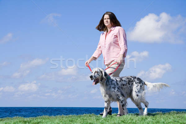 Walking the dog Stock photo © alexeys