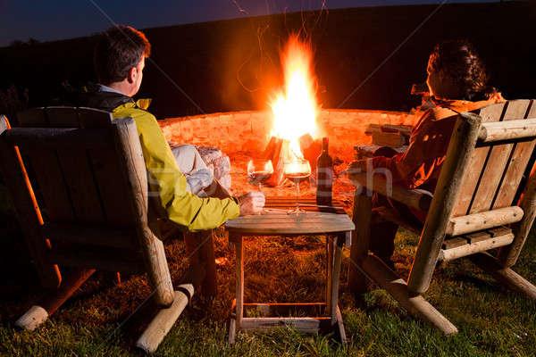 たき火 カップル 座って ワイン 女性 ストックフォト © alexeys