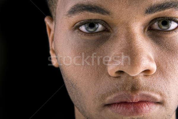 Jóképű afroamerikai férfi portré fiatal sötét háttér Stock fotó © alexeys