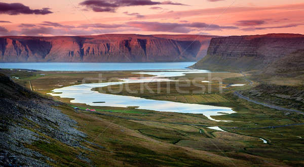 Cênico ver Islândia pôr do sol céu grama Foto stock © alexeys