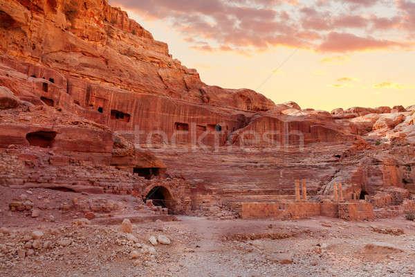 Anfiteatro ruínas antigo nuvens pôr do sol deserto Foto stock © alexeys
