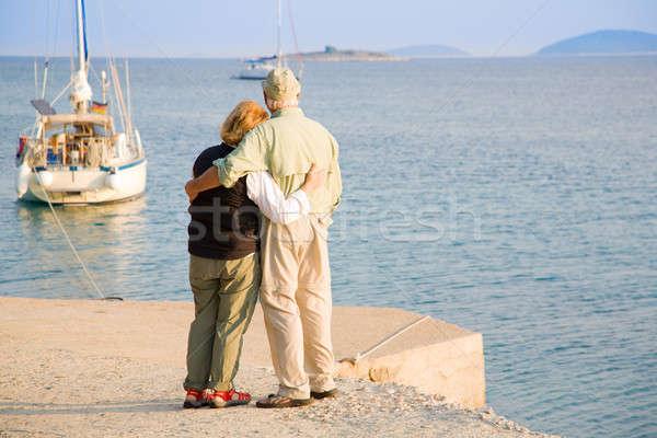 Boldog nyugdíj idős pár néz vitorlások el Stock fotó © alexeys