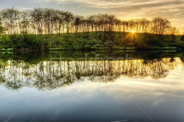 Sunset on the lake Stock photo © alexeys