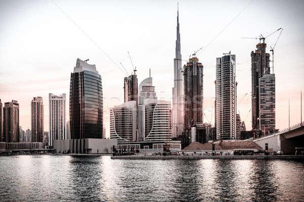 Dubai belváros sziluett festői kilátás naplemente Stock fotó © alexeys