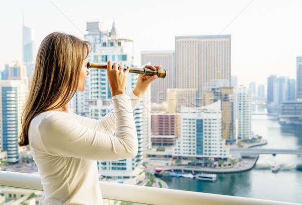 Nő toronyház erkély néz város építészet Stock fotó © alexeys