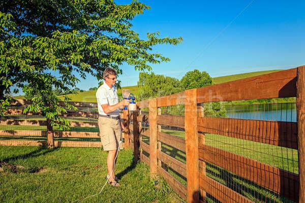 Fence staining Stock photo © alexeys