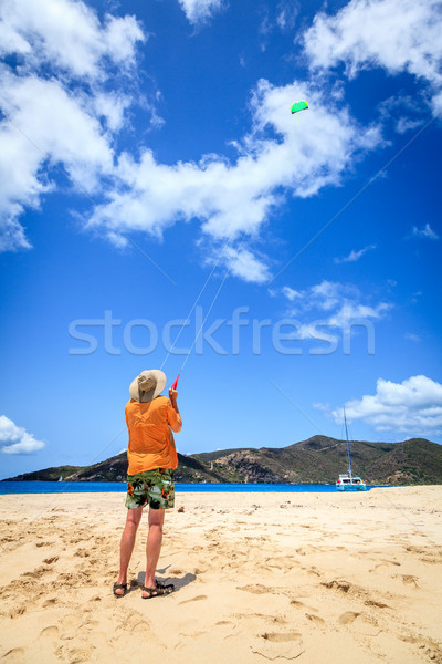 Flying кайт человека тропический пляж Карибы небе Сток-фото © alexeys