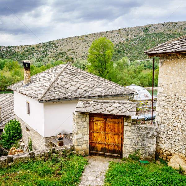 Village vue vieux arbres bâtiments pierre Photo stock © alexeys
