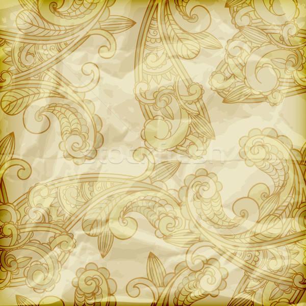 vector seamless paisley pattern  on crumpled golden foil texture Stock photo © alexmakarova