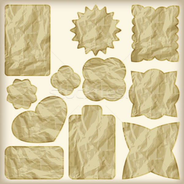 set of foil cut golden shiny vintage tags,  crumpled paper tex Stock photo © alexmakarova