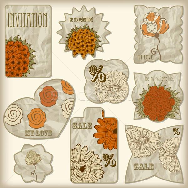 set of foil cut golden shiny vintage tagswith floral pattern,  Stock photo © alexmakarova