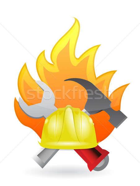 construction tools on fire Stock photo © alexmillos