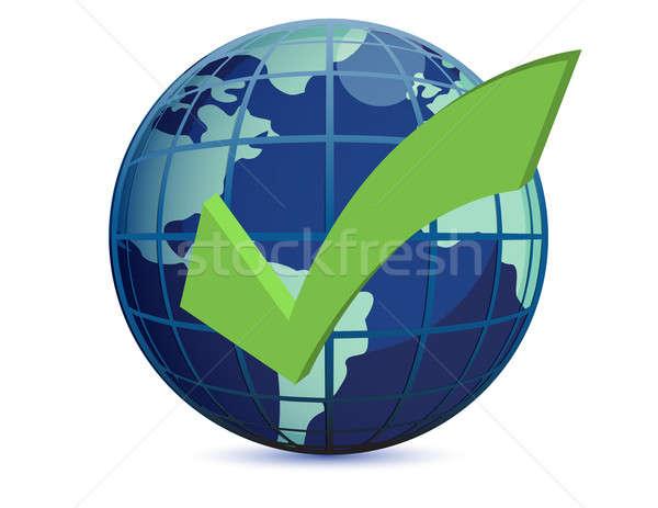World globe and checkmark over a white backgorund Stock photo © alexmillos