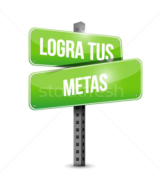 achieve your goals street sign in Spanish Stock photo © alexmillos