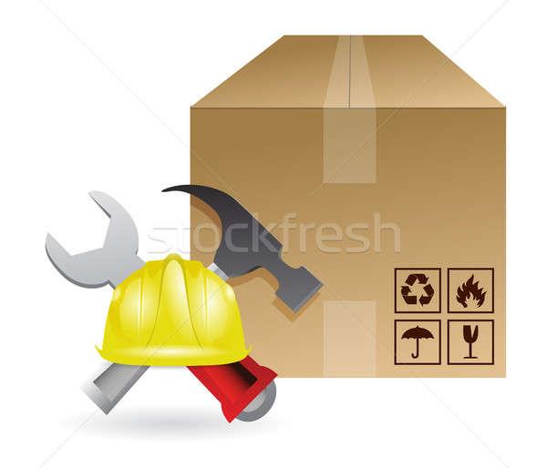 Shipping box and construction tools Stock photo © alexmillos