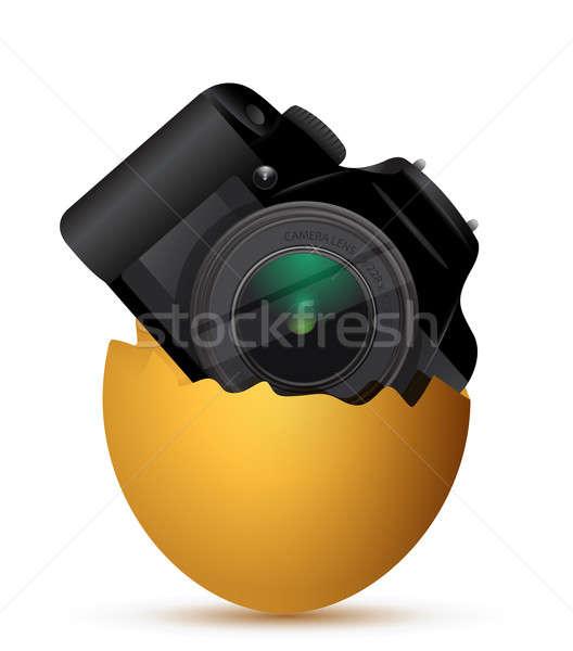 Camera inside a broken egg  Stock photo © alexmillos