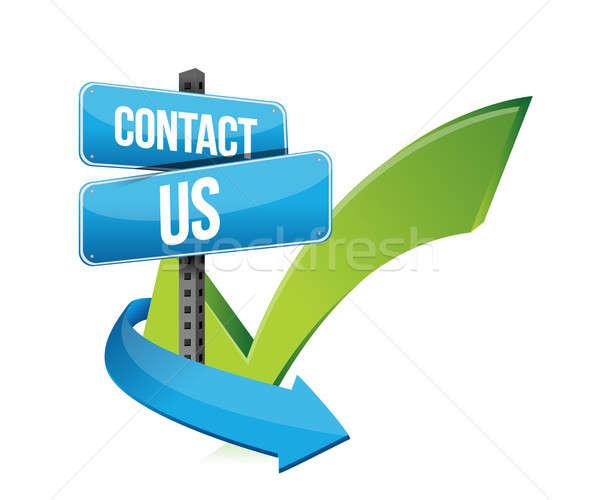 Contact us at sign and checkmark Stock photo © alexmillos