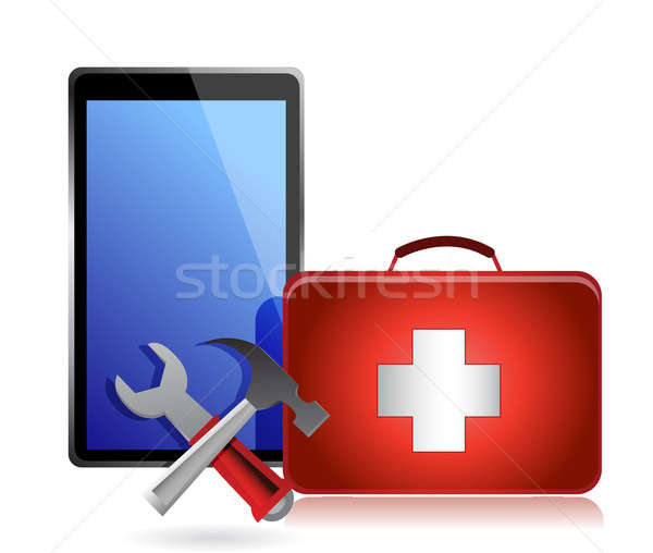 Tablet with tools and a first aid kit on a white background Stock photo © alexmillos
