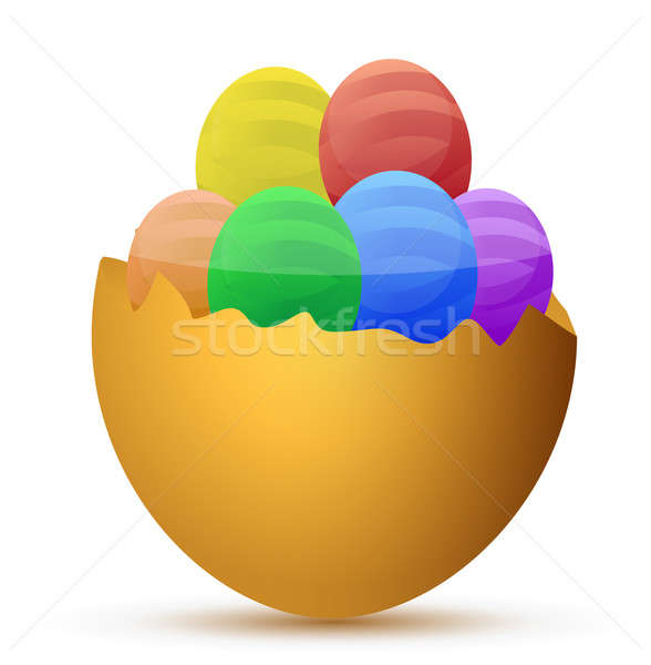 Broken egg filled with little chocolate eggs Stock photo © alexmillos