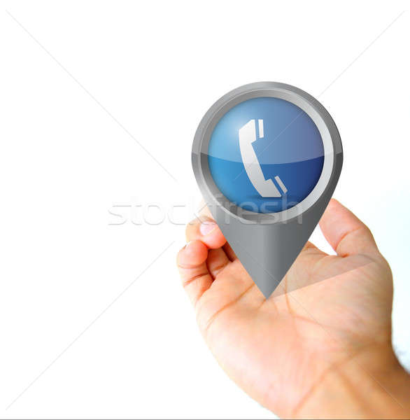 Hand holding a communication pin pointer icon  Stock photo © alexmillos