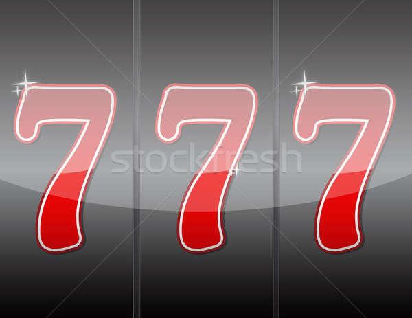 777. Winning in slot machine.  Stock photo © alexmillos