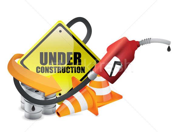 Under construction sign with a gas pump nozzle Stock photo © alexmillos
