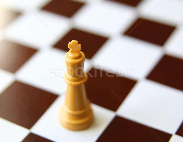 Közelkép király sakkfigura sakk erő játék Stock fotó © alexmillos