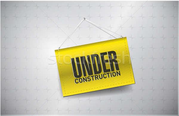 under construction sign hung Stock photo © alexmillos